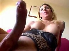 The arousing blonde is trim, sexy, and blessed with big perky tits. She has a really big coc...