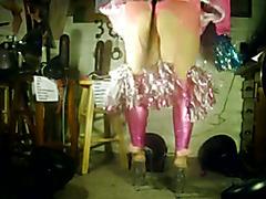 Wearing pink leggings, pink garter belt, pink panties, pink/white frilly micro skirt and cle...