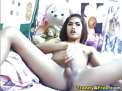 Pretty Asian Tranny playing her hard dick in front of the cam! But she was unable to hold of...