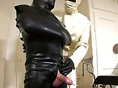 Rubber doctor leila plays with a real horny rubber cock toy. She wears a white rubber doctor...