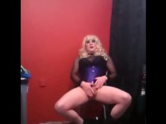 The phone camera is setup to record and the sissy in a wig and lingerie hangs out in front o...