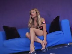 The glamorous and beautiful shemale sits on the couch, whips out her cock, and begins to mas...