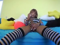 She steps on camera in her striped stockings and whips out her big black cock to show you ho...