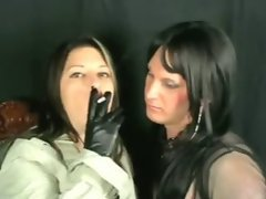 The sexy mistress in black leather boots uses the sissy mouth as an ashtray and blows smoke ...
