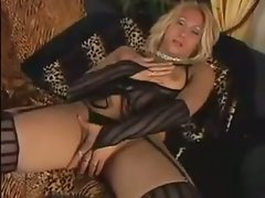 Blonde tgirl beats off a load