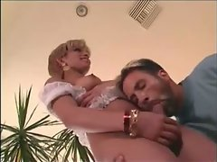 The short blonde hair and white lace lingerie are sexy on the transsexual slut and the way h...