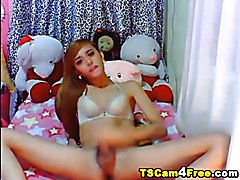 Hot Asian tranny loves to play her dick in front of the cam! She first gives us a nice view ...