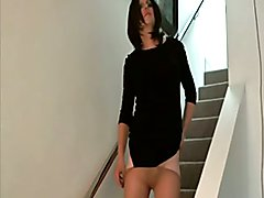 On the stairs in short black dress and nude pantyhose but no panties. You can see my cock, b...