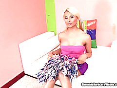 A sexy blonde tranny cheerleader with big tits takes a load from a stud