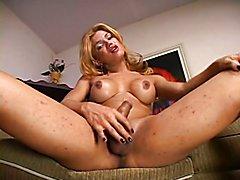 Slutty tranny with ugly face is masturbating her dick on the sofa