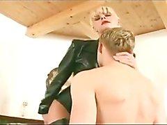 Blonde dominatrix leather