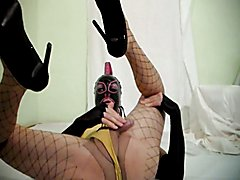 Tranny in a latex mask cumming hands-free in her pantyhose