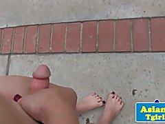 Oriental tranny tugging outdoors in a bikini