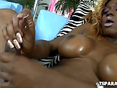 Storm is a busty ebony shemale babe who is having a fun time playing with a dildo and stroki...