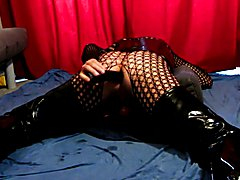 Crossdresser slave in latex and crotch boots fucking his ass
