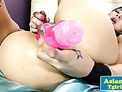 Alternative asian tgirl tugs with toy in ass
