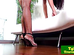 Solo ladyboy jerking while in stockings then fingers her tight ass