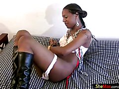 Awesome black shemale with long dark hair sticks her curvy ass in the air and fills it up wi...