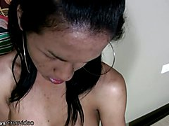 Gorgeous Asian shemale is doing striptease before blowjob