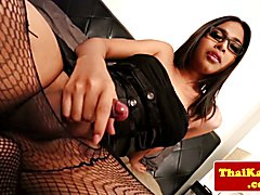 Lingerie wearing ladyboy with glasses wanking off and jizzing