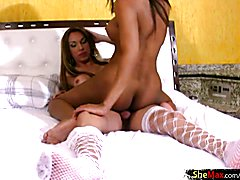 Tranny babe in while lingerie tongues her TS girlfriend tits
