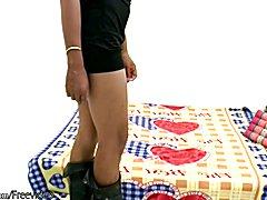 Hairy Thai TS model in black lingerie strokes her ladystick