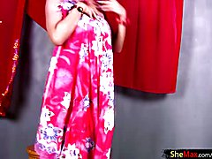Thai tranny is dancing in colorful dress before jerking off