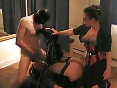 A transvestite is used by her Mistress and a male