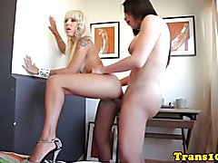 Lesbian tranny assfucks pierced tattooed babe and facializes her