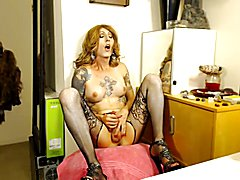 Tatooed Tranny blows a load.