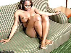 Ebony shemale shakes big ass and covers shecock with lotion  - clip # 02