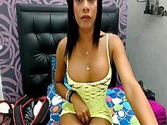 Dark skinned colombian shemale stroking cock while chatting2