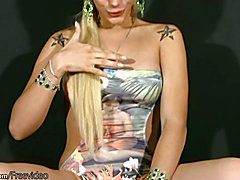 Transsexual with long blonde hair plays with shaft and balls