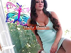 She and buxom genetic girl Holly Heart make out by the pool, promising not to tell Tarynxo's...