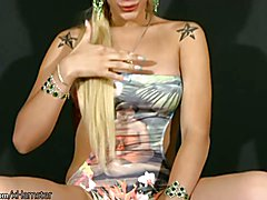 This shemale looks exotic in her backless swimsuit and it shows her tight firm body off to f...