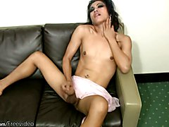 Black haired ladyboy is masturbating on couch till cumshot