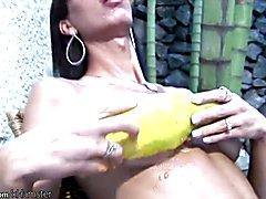 Slim tgirl in black fishnets spreads papaya all over herself  - clip # 02