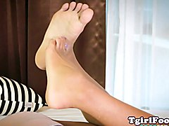 Foot loving lingerie ladyboy curling her toes