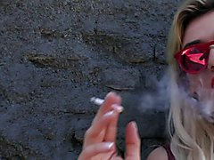 Smoking seductively on the streets of Sao Paulo, dark-haired Fernanda Cristine and blonde Gi...