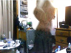 Tranny playing naked in the bed and using a brush as a dildo