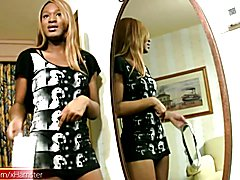 This lovesome ebony teen shemale had long blonde hair and a hot innocent smile along with a ...