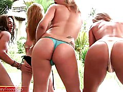 Naughty shemales showcase big asses in tiny thong outdoors