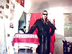 Crudelitas wearing her heavy black leather Gestapo coat