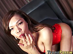 Hot shemale jerks off her big cock until explodes her jizz