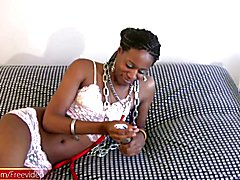 Watching this kissable ebony shemale pose in her skimpy top and thongs, with knee high leath...