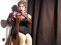 "Sexyputa slip on ""brown ff seamed nylon stockings and"" adjusts her garters"