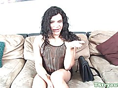 Casting tgirl strips and jerks her hard cock for the camera