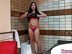 Shemale Sara Oliveira masturbates with a dildo up her ass