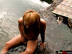 Redhead ladyboy wanks outdoors while giving oral pleasure