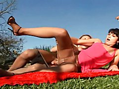 Shemale fucks chick on the grass